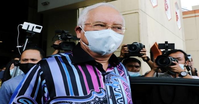 Former Malaysian Prime Minister Najib Razak leaves after a meeting at United Malays National