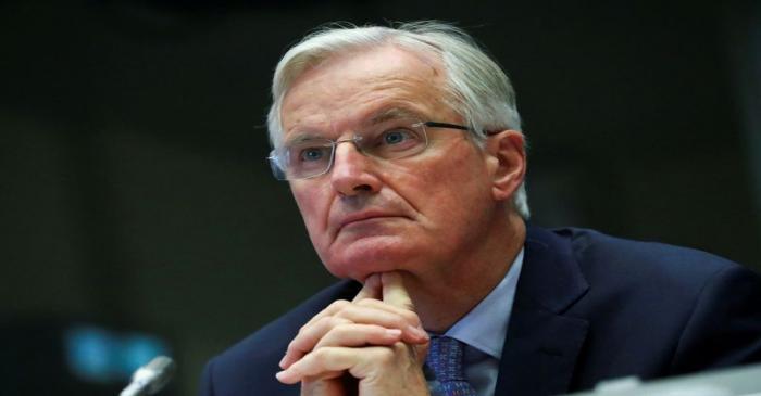 FILE PHOTO: The European Union's Brexit negotiator Barnier addresses the European Economic and