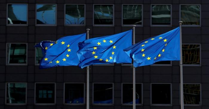 FILE PHOTO: European Union flags flutter outside the European Commission headquarters in