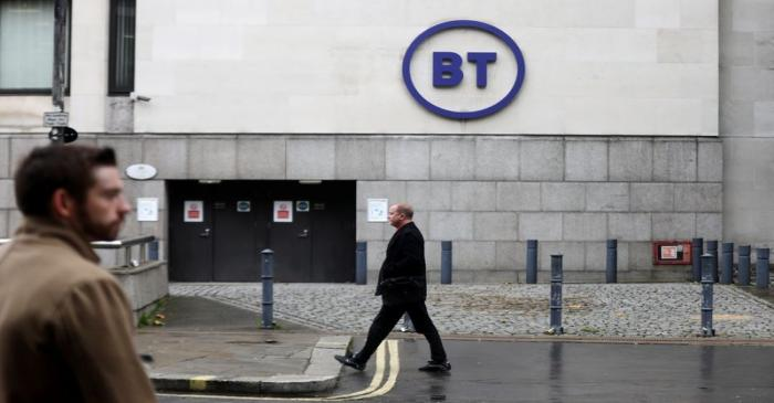 People walk past British Telecom headquarters in London