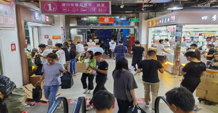Shoppers look to pick up cosmetic products from wholesalers inside the Mingtong Digital City