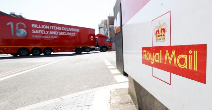 The logo of Royal Mail is seen outside the Mount Pleasant Sorting Office as a delivery vehicle