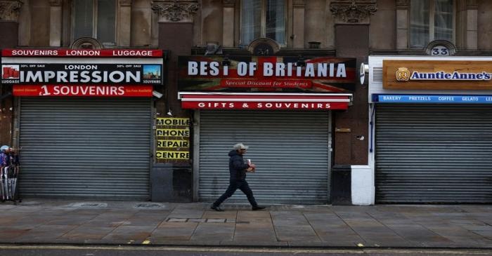 A pedestrian walks past shuttered stores amid the coronavirus disease (COVID-19) outbreak in