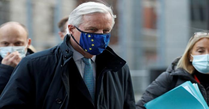 FILE PHOTO: European Union's chief Brexit negotiator Michel Barnier, wearing a face mask,