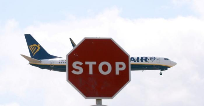 FILE PHOTO: A Ryanair Boeing 737 airplane passes a Stop sign as it lands at Barcelona-El Prat