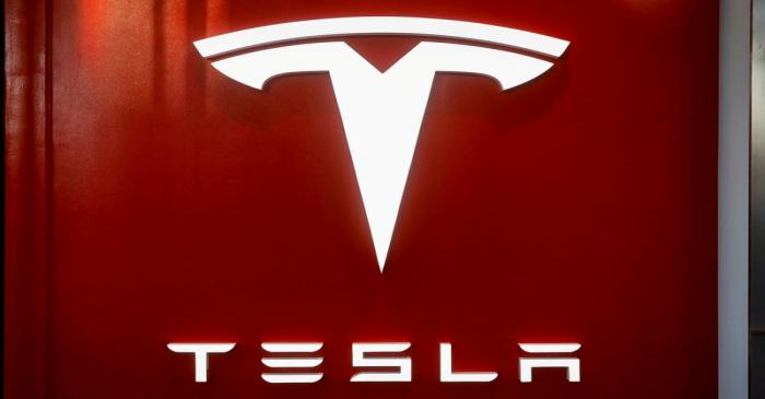 FILE PHOTO: The Tesla logo is seen at the entrance to Tesla Motors' showroom in Manhattan's