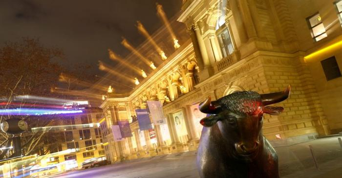 FILE PHOTO: The bull, symbol for successful trading, is seen in front of the German stock