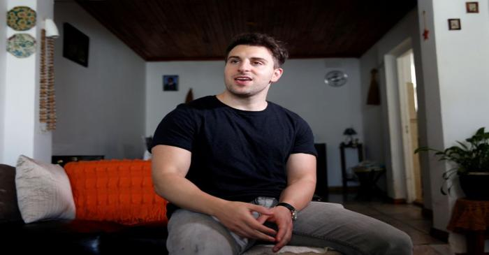 FILE PHOTO: Co-founder and CEO of Airbnb Brian Chesky speaks during an interview in Langa