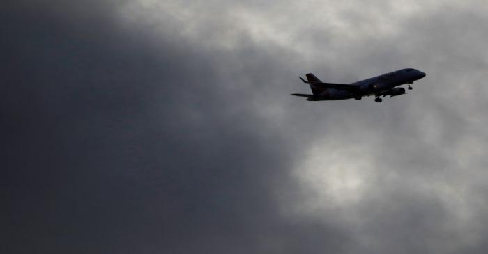 A plane prepares to land at the Nantes Atlantique airport in Bouguenais