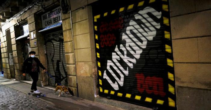 FILE PHOTO: FILE PHOTO: A woman is pictured with her dog in Barcelona, Spain, during an October