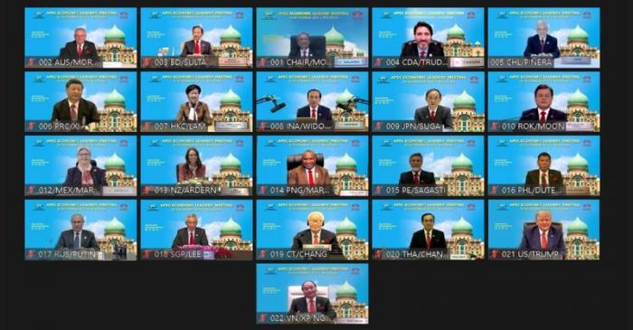 A screenshot shows participants of the virtual APEC Economic Leaders Meeting 2020 pose for a
