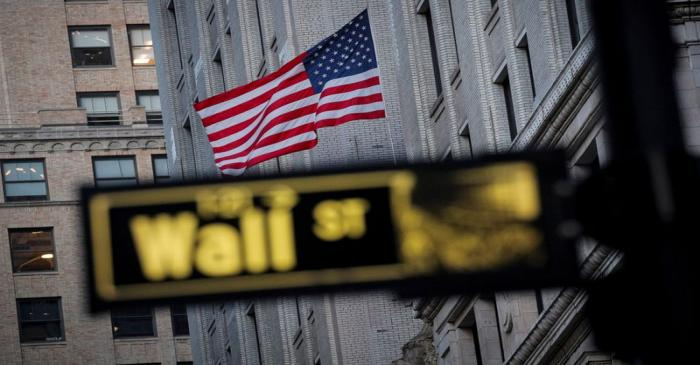 FILE PHOTO: The U.S. flag is seen on a building on Wall St. in the financial district in New