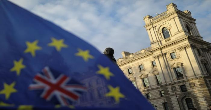FILE PHOTO: A flag is seen outside the Houses of Parliament near the statue of former Prime