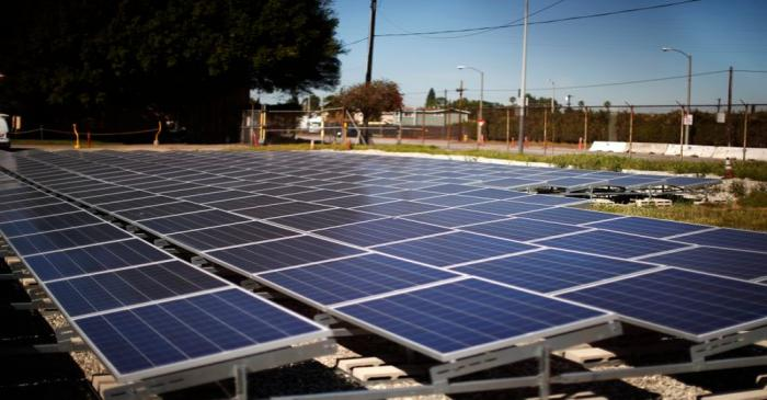 Solar panels are seen next to a Southern California Edison electricity station in Carson