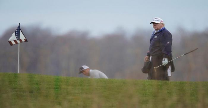FILE PHOTO: U.S. President Donald Trump plays golf at the Trump National Golf Club in Sterling,