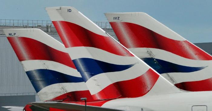 FILE PHOTO: File photo of British Airways logos on tailfins at  Heathrow Airport in London