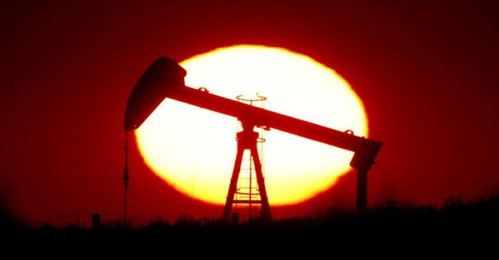 FILE PHOTO: The sun sets behind a pump-jack outside Saint-Fiacre
