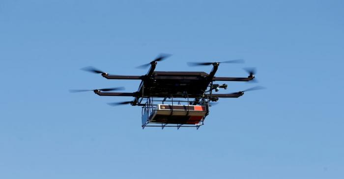 FILE PHOTO: A drone demonstrates delivery capabilities from the top of a UPS truck during