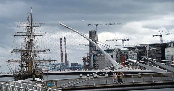 Cranes are seen along the skyline in the Irish Financial Services Centre in Dublin