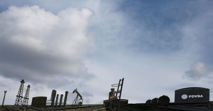 FILE PHOTO: The logo of the Venezuelan oil company PDVSA and cut-outs depicting oil facilities