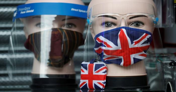 FILE PHOTO: A Union Jack design face mask is seen for sale in the window of a shop amid the