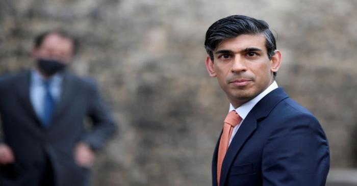 FILE PHOTO: Britain's Chancellor of the Exchequer Rishi Sunak looks on as he leaves following