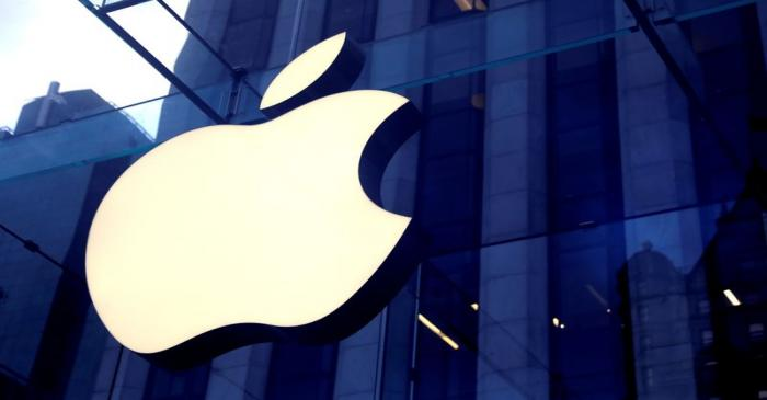 FILE PHOTO: FILE PHOTO: The Apple Inc logo is seen hanging at the entrance to the Apple store