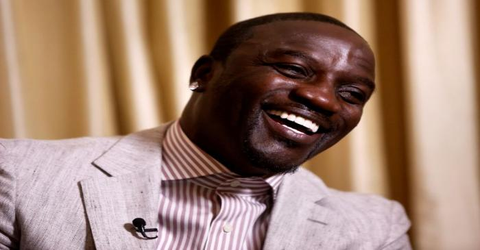 FILE PHOTO: Singer Akon laughs during an interview in New York