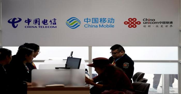 FILE PHOTO: Signs of China Telecom, China Mobile and China Unicom are seen during the China