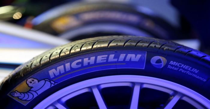 The logo of French tyre maker Michelin is seen on a Formula E racing car during a news