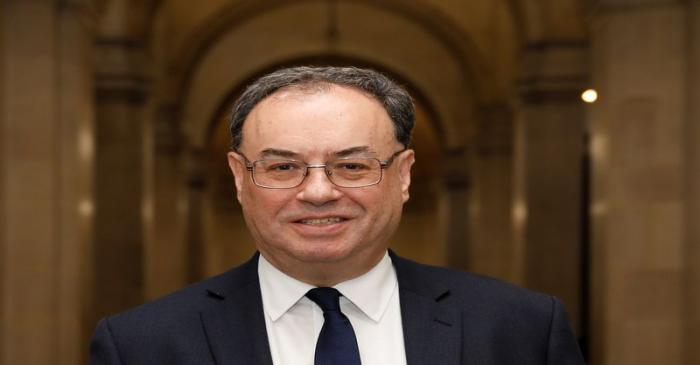 Bank of England Governor Andrew Bailey poses for a photograph on the first day of his new role