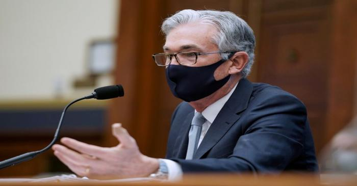 FILE PHOTO: Federal Reserve Chairman Jerome Powell responds to a question during a House