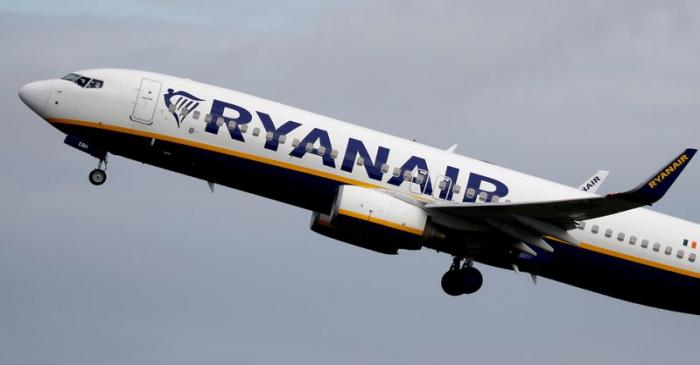 FILE PHOTO: FILE PHOTO: A Ryanair plane takes off from Manchester Airport as the spread of the
