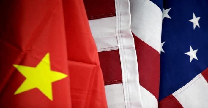 FILE PHOTO: Flags of U.S. and China are displayed at AICC's booth during China International