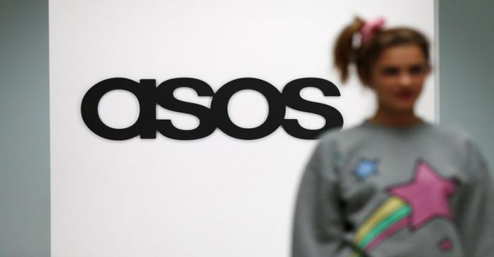 FILE PHOTO: A model walks on an in-house catwalk at the ASOS headquarters in London