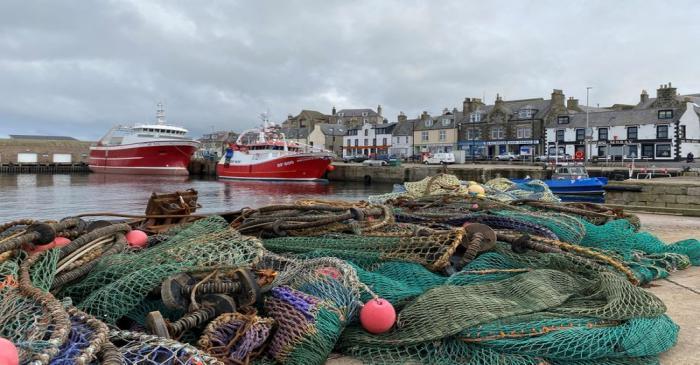 FILE PHOTO: Fishing boat sits docked in Macduff, Aberdeenshire