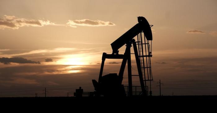 FILE PHOTO: Oil pump jacks work at sunset near Midland