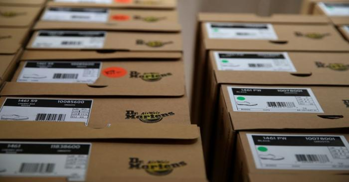 Boxes of Dr. Martens shoes are pictured in the warehouse of local footwear retailer