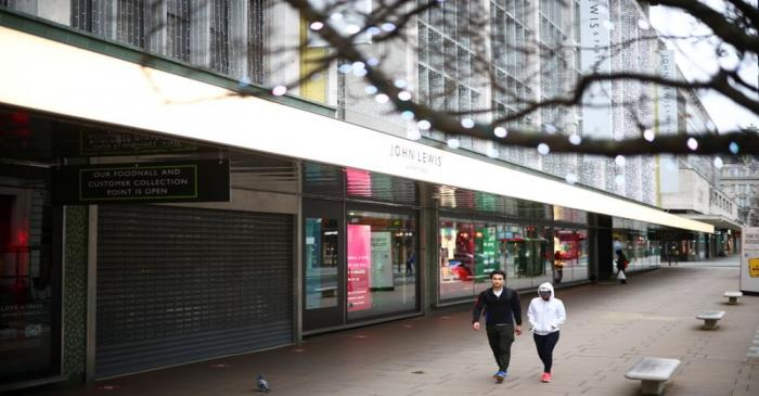 People walk along Oxford Street as shops remain closed under Tier 4 restrictions, amid the