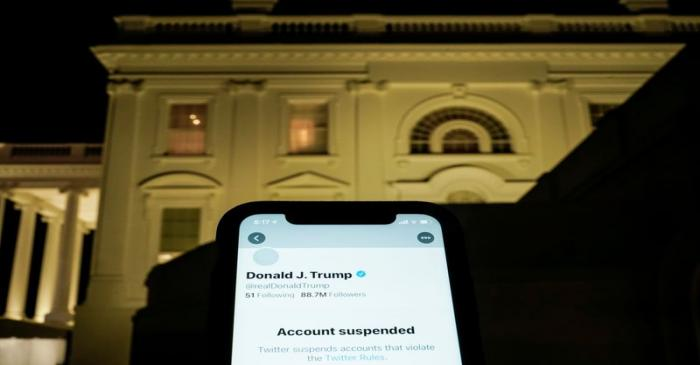 A photo illustration shows the suspended Twitter account of U.S. President Donald Trump on a