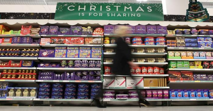 FILE PHOTO: File photograph of a woman shopping at a Sainsbury's store in London