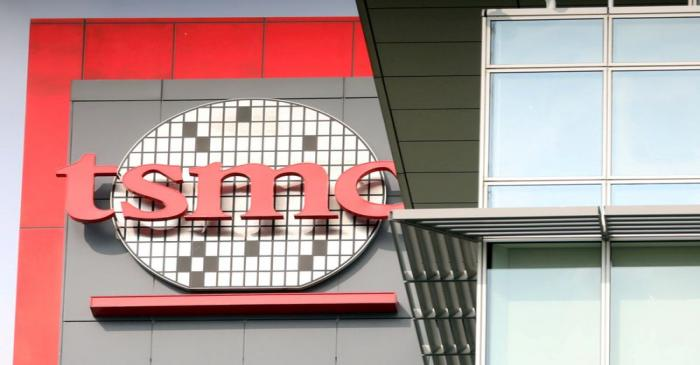 FILE PHOTO: A logo of Taiwan Semiconductor Manufacturing Co (TSMC) is seen at one of its office