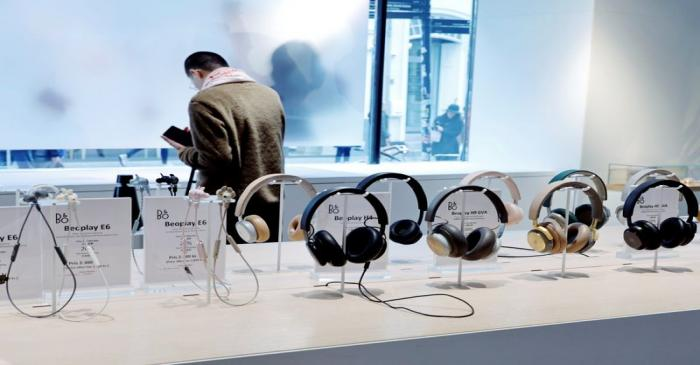 A woman looks on in the Bang & Olufsen flagship store in Copenhagen