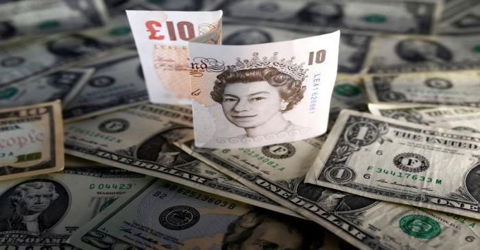 U.S. dollar and British pound notes are seen in this picture illustration