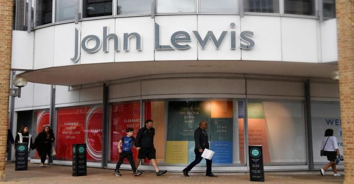 Shoppers are seen walking past a John Lewis store, in London