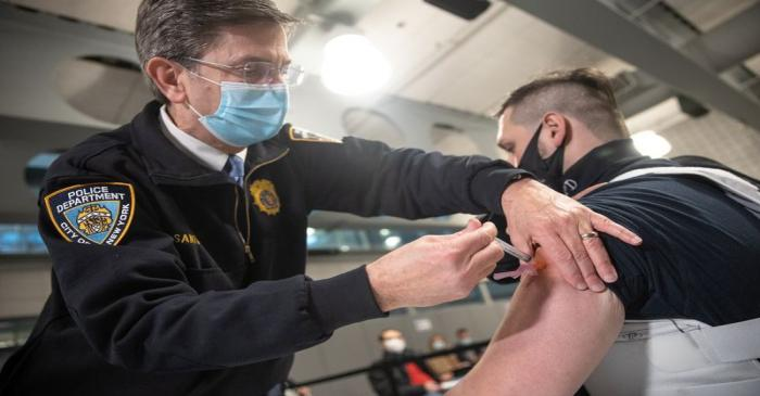 Members Of New York Police Department Receive Covid-19 Vaccine
