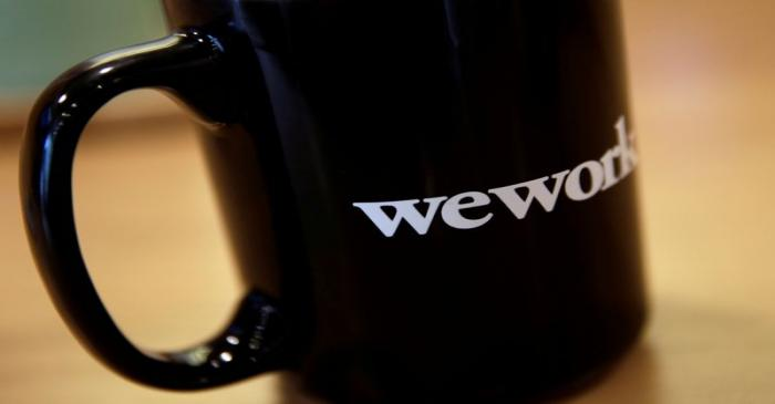 FILE PHOTO: The WeWork logo is seen on a cup at a WeWork office in Beijing