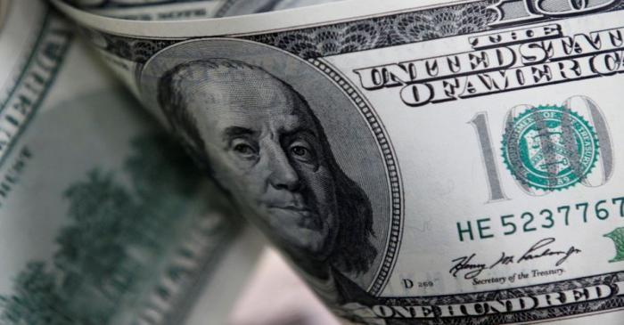 FILE PHOTO: U.S. one hundred dollar notes are seen in this picture illustration taken in Seoul
