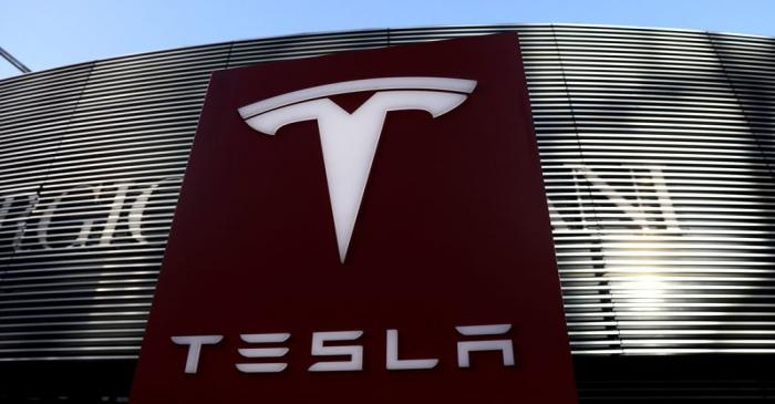 FILE PHOTO: Logo of electric vehicle maker Tesla is seen near a shopping complex in Beijing