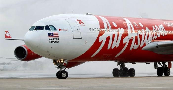 FILE PHOTO:  File photo of an AirAsia X Airbus passenger jet arriving at Orly airport near